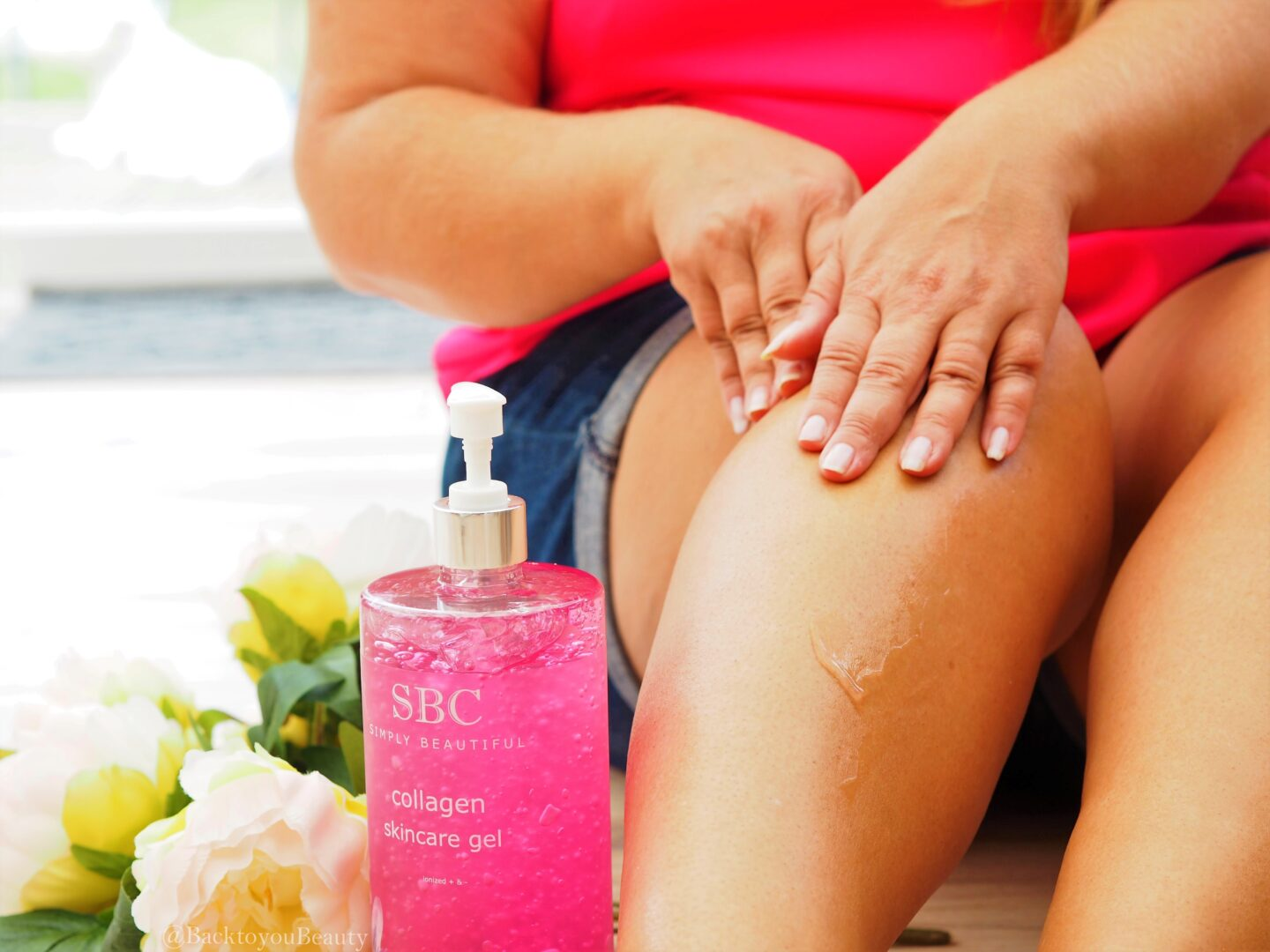 Applying SBC Collagen Skincare gel to my legs