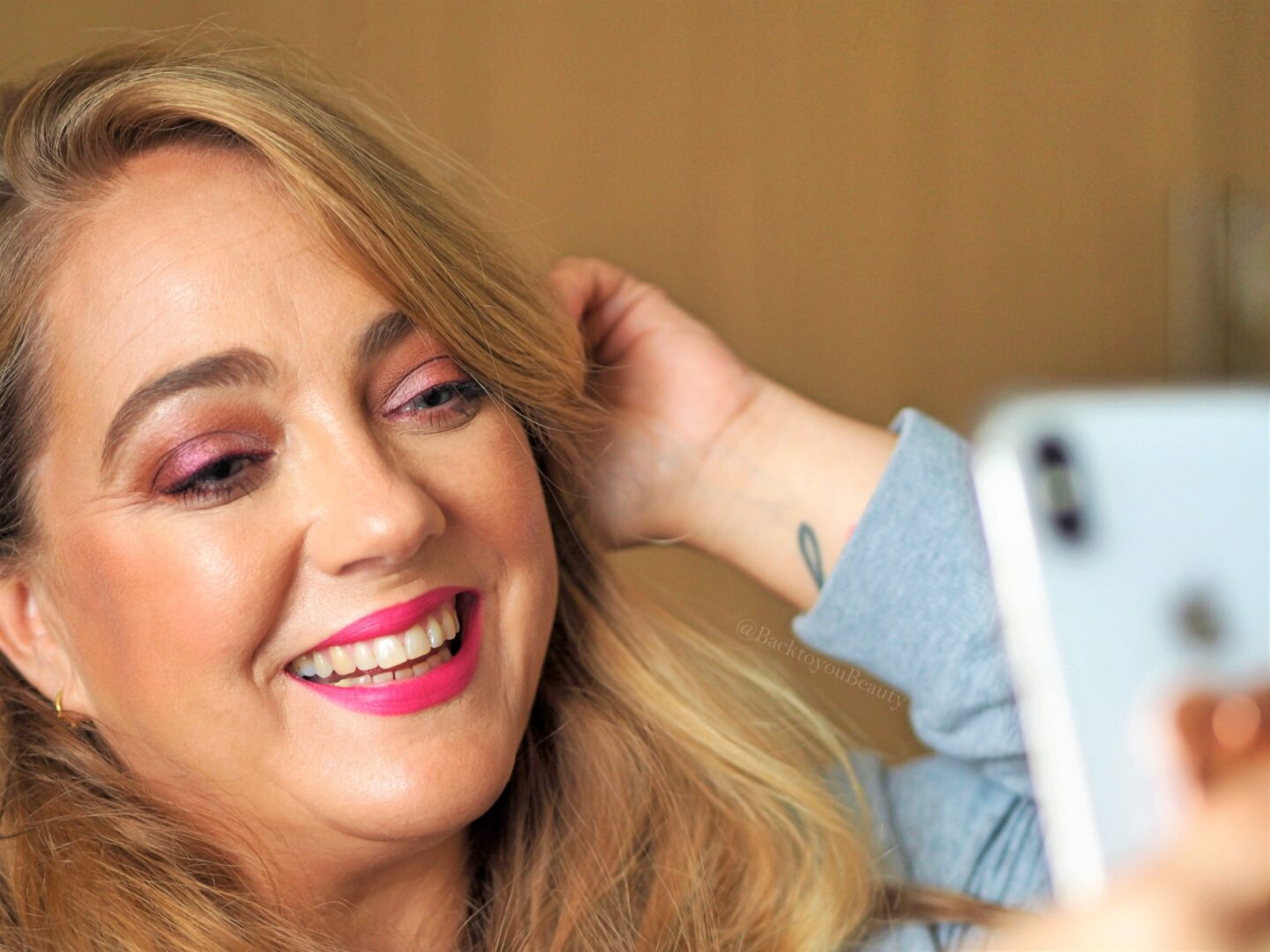 Back to you beauty in full face of Too Faced smiling