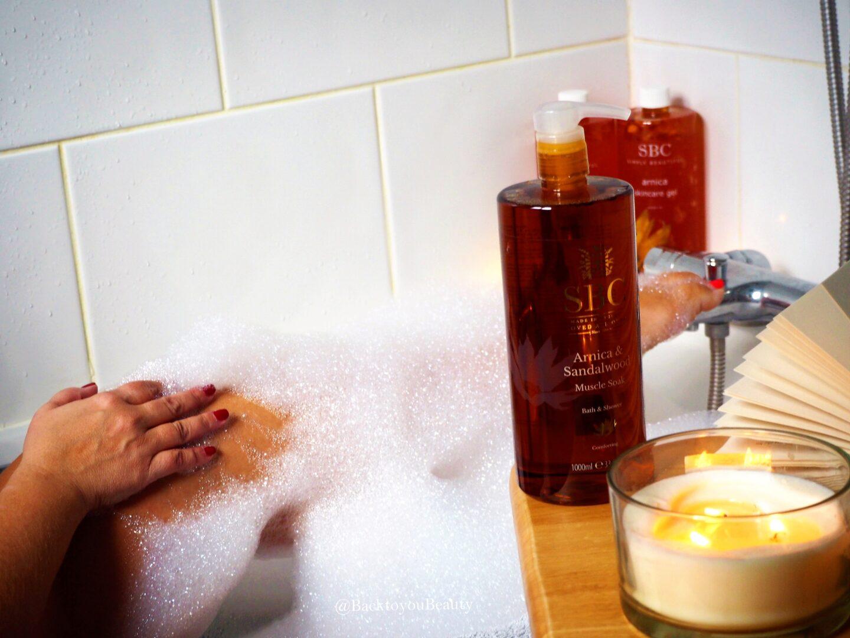 Bathing in SBC Arnica and Sandalwood muscle soak