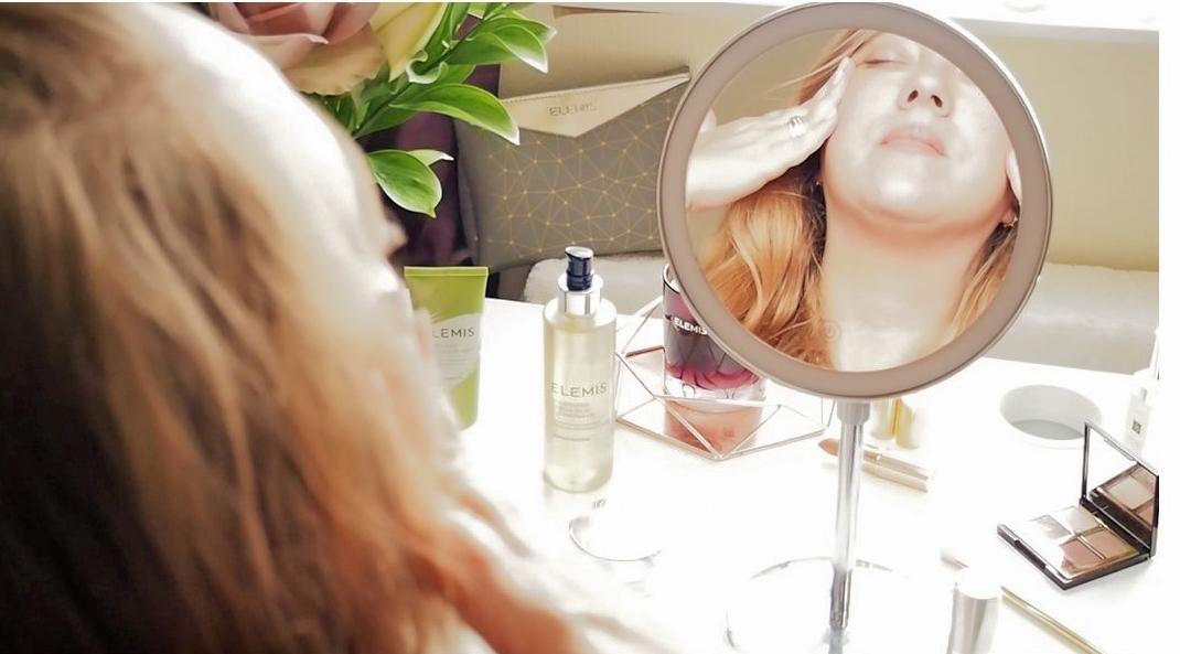 Applying Elemis Pro-Collagen Definiton Face & Neck Serum