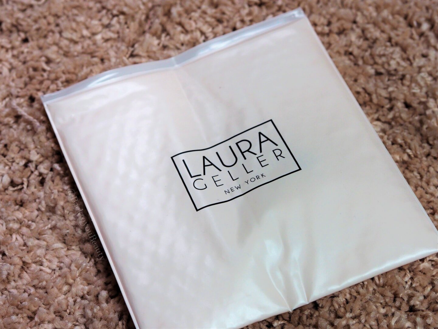 Laura Geller cosmetic bag