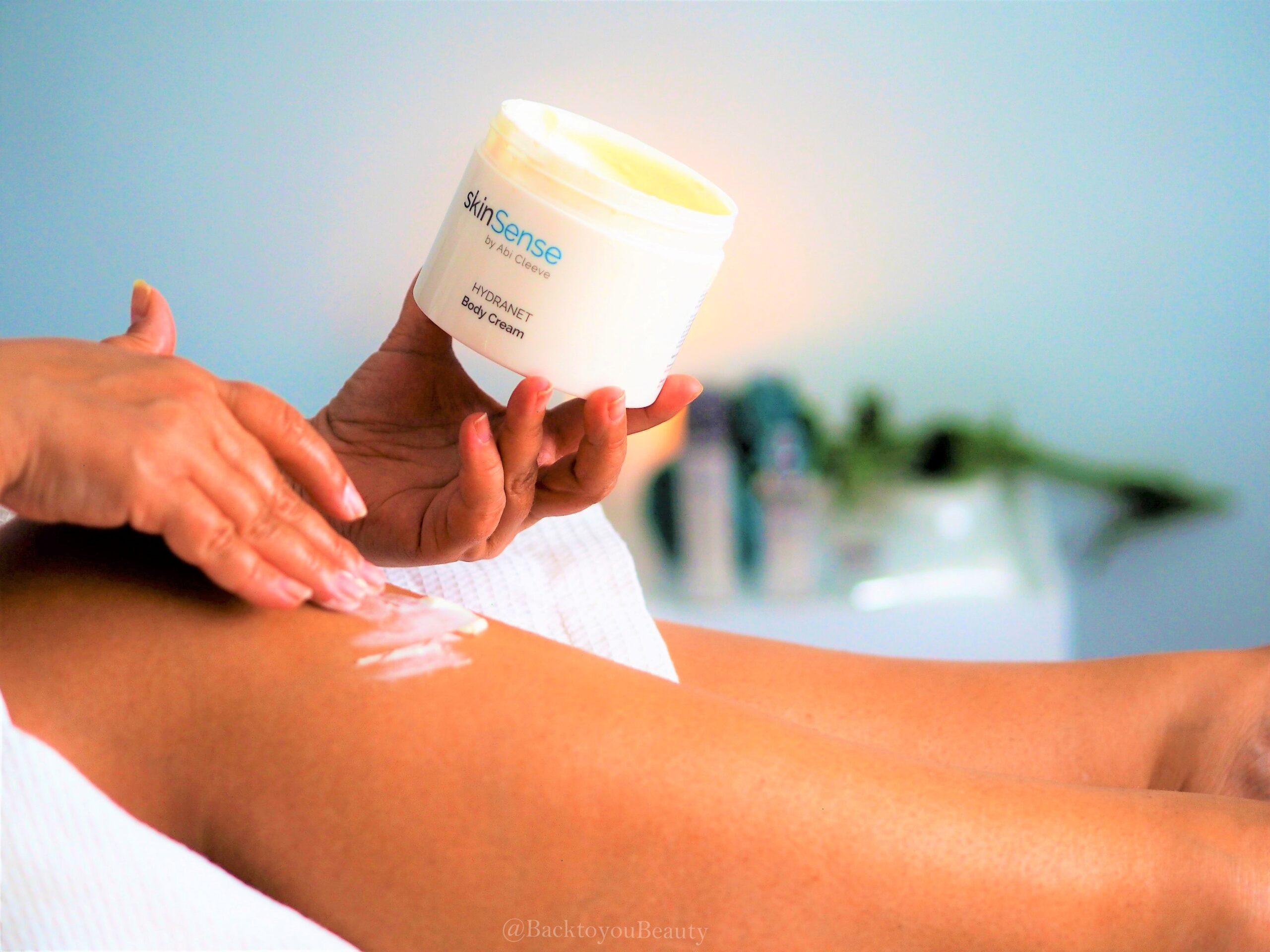 Applying Hydranet Body Cream to legs