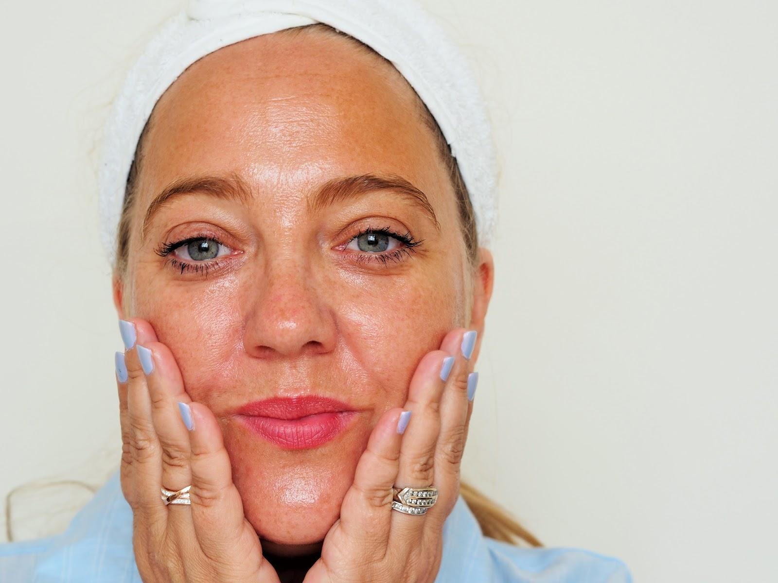 applying elemis pro collagen marine oil