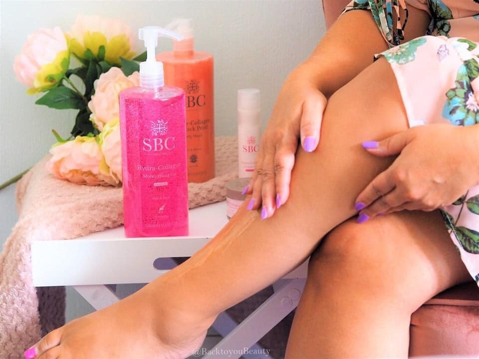 applying Hydra Collagen to legs